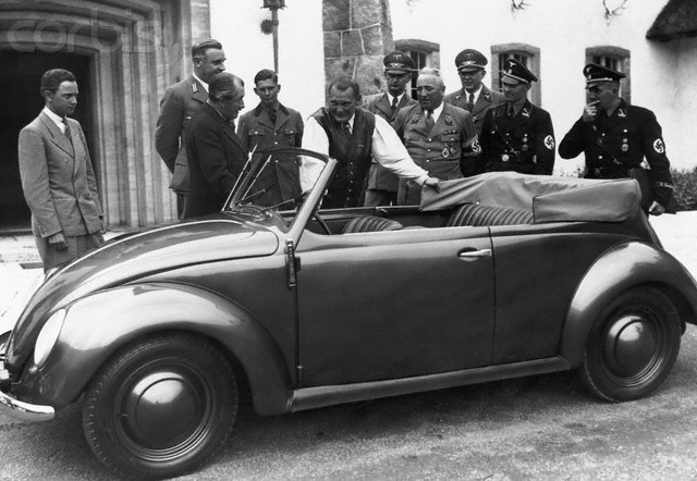 Hermann20Goering20stands20next20to20a20Volkswagen20convertible20at20Carinhall20hunting20lodge2C20with20Robert20Ley20and20Ferdinand20Porsche.jpg